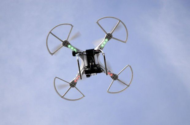 (A drone at work. These cost as little as $200. Photo via AP)