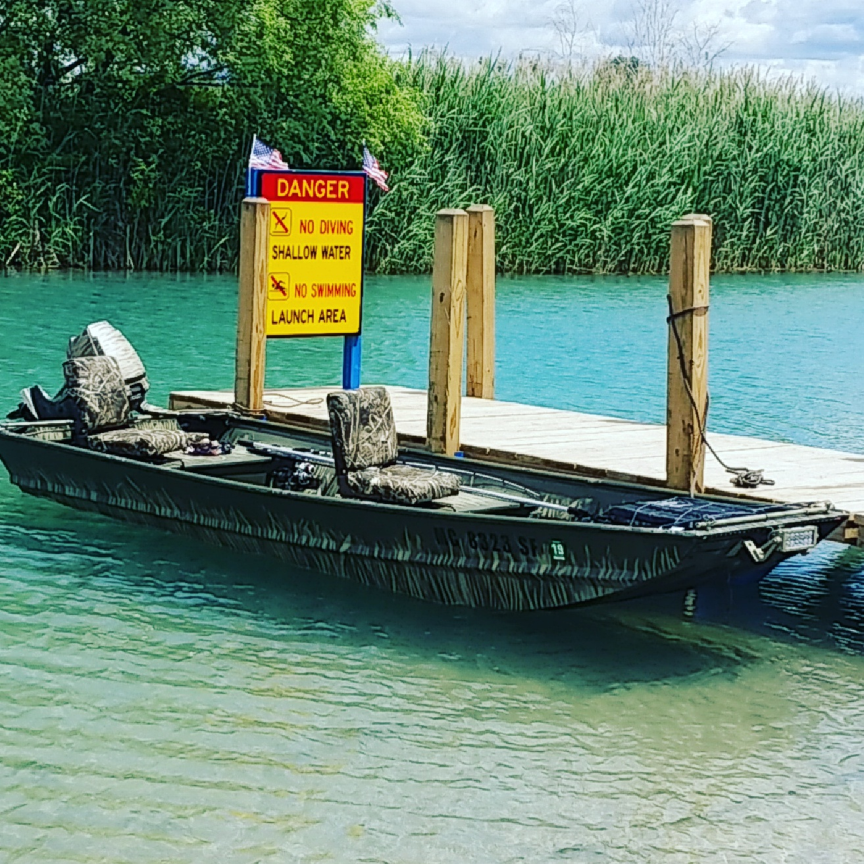 14ft Jon Boat W 7 5hp Outboard