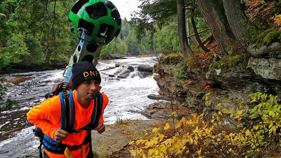 DNR Wildlife Division employee takes the Google Trekker through rivers and waterfalls for a Street View for partnership between Pure Michigan and Google. (Photo via Facebook)