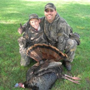 Me and the boy with the my Biggest Gobbler W/Dbl Beard 05/09